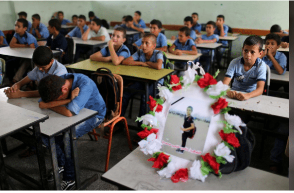 Classmates mourn boy shot dead by Israeli troops in Gaza border